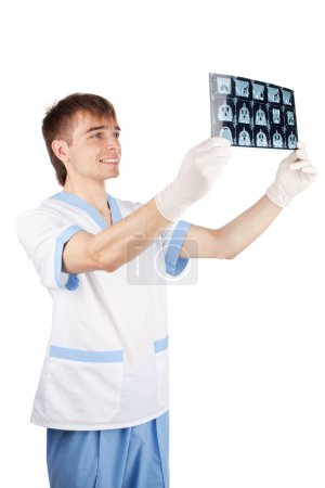 Smiling medical doctor looking at CT computer tomography scan im