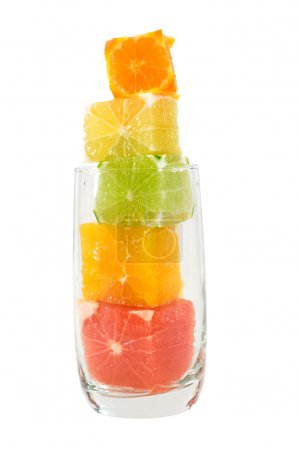 Photo for Natural fruit juice abstract - citrus cubes in a glass - Royalty Free Image