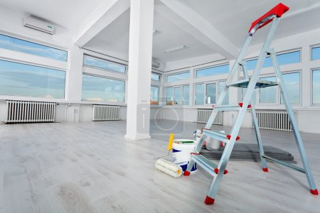 Photo for Newly renovated generic empty office space with leftover materials and ladder in foreground - Royalty Free Image
