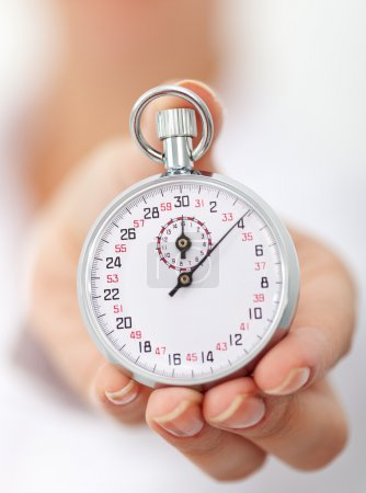 Stopwatch in womans hand - closeup