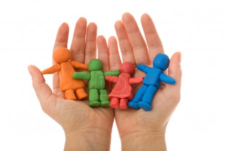Woman hands holding colorful clay family