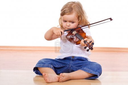 Little girl on the floor with a violin