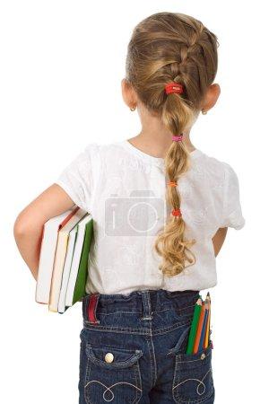 """Photo pour Petite fille retournant à l """"école avec beaucoup de crayons et de livres - isolée - image libre de droit"""