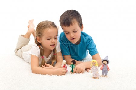 Photo for Care free kids playing with puppets laying on the floor - isolated - Royalty Free Image