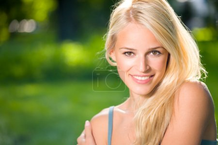 Portrait of young beautiful sexy smiling woman outdoors