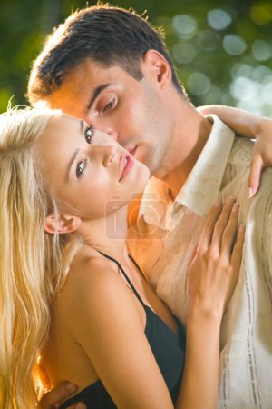 Young attractive happy love couple together, outdoors