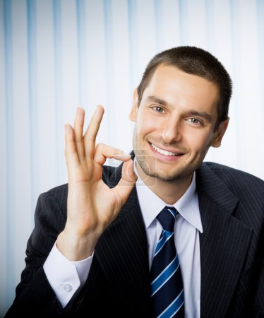 Businessman with okay hand sign at office