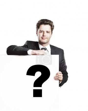 Young businessman holding a white board with a question mark