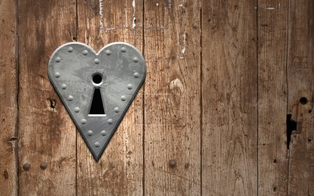 Photo for Heart keyhole on a wooden door - Royalty Free Image