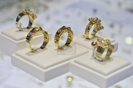 Fife golden rings in a jewelry store on display fo...