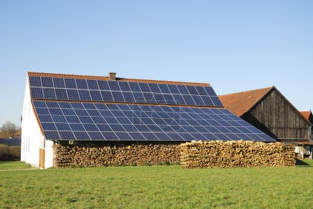 Photo for Old farm house with innovative photovoltaic installation - Royalty Free Image