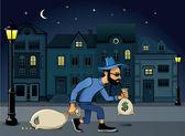 Burglar walking jo the street at night