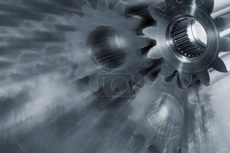 Photo pour Roues de transmission en titane, léger effet de zoom et tonalité bleue - image libre de droit