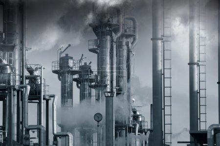 Photo for Oil and gas refinery, surrounded by toxic clouds and vapours, pollution concept, blue toning. - Royalty Free Image
