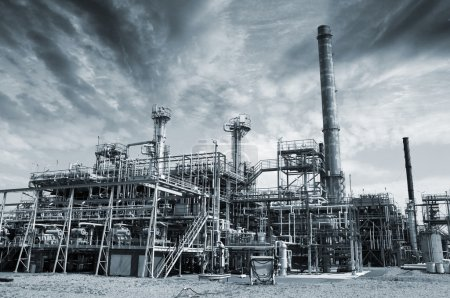 Photo for Oil and gas refinery, stormy dark industrial clouds above - Royalty Free Image