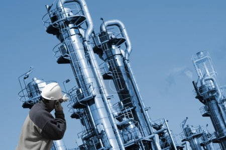 Worker with oil and fuel towers