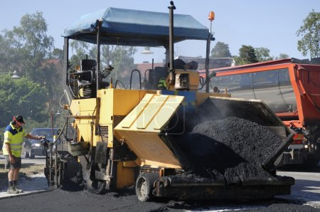 Asphalt paving and worker