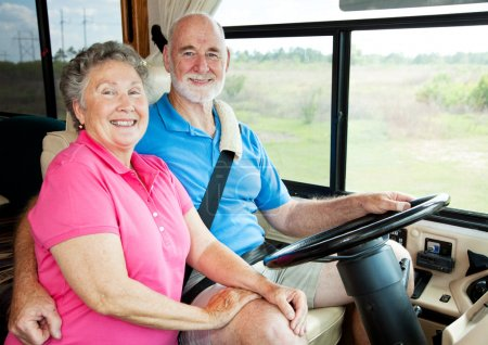 Photo for Portrait of active senior couple in their motor home. - Royalty Free Image