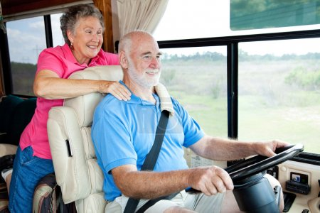 Photo for Senior couple traveling in their motor home. The husband is driving. - Royalty Free Image