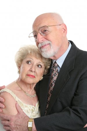 Photo for A handsome senior couple looking worried as they face the future. - Royalty Free Image