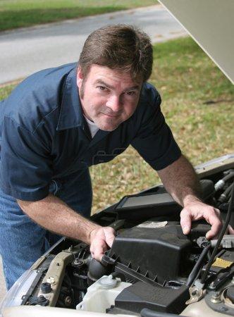 Handsome Mechanic Under Hood