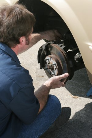 Mechanic Adjusting Brakes