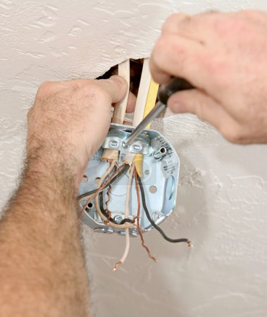 Electrician Attaching Ceiling Box