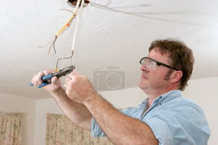 Electrician Straightents Wire