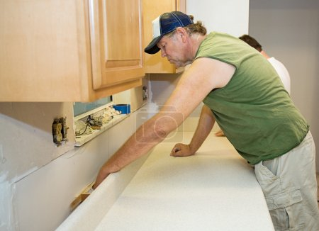 Contractor Installs Laminate Counter