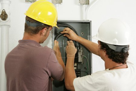 Electricians Install Panel