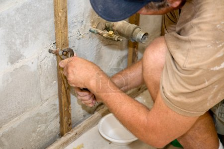 Plumber Working with Pliers