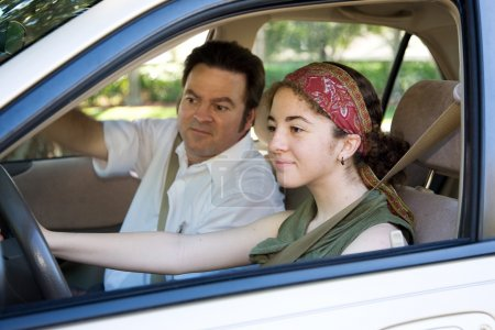 Photo for Teen learning to drive or taking driving test. - Royalty Free Image
