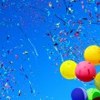 Multicolored balloons and confetti in the city fes...