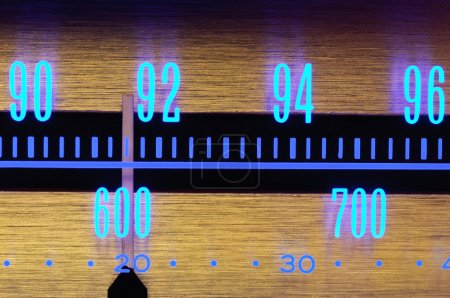 70´s Old radio dial close-up with glowing scale n...