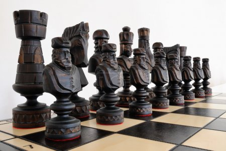 Big Chess pieces on wood board