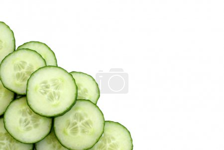 Photo for Many cucumber slices at the bottom left of the frame, leaving room for copy-space. - Royalty Free Image