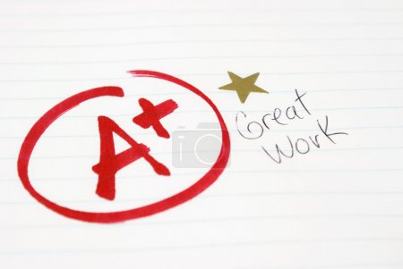 Photo for An A plus is given to a student for great work being achieved. - Royalty Free Image