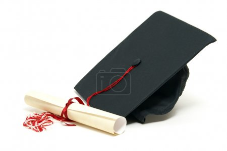 Photo for A diploma certificate alongside a grad hat to celebrate the students success. - Royalty Free Image