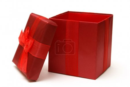 Photo for An empty red gift box with the lid off for easy insert of your merchandise in a photo editing program. - Royalty Free Image