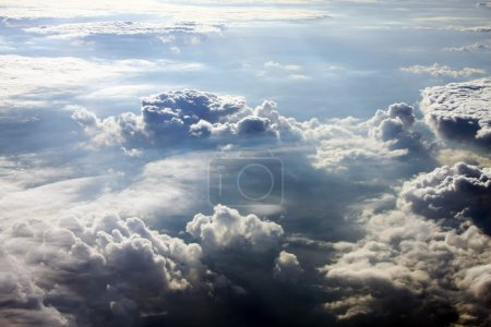 Photo for From above it is not so terrible. The stormy clouds shined from above with the sun. View from airplane. - Royalty Free Image