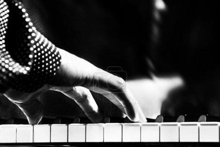 A man playing piano closeup