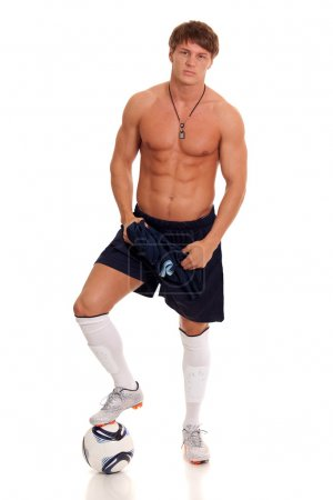 Male soccer player. Studio shot over white.
