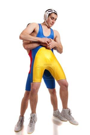 Two male wrestlers. Studio shot over white.
