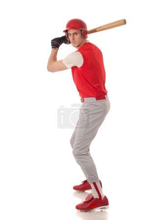 Male baseball player. Studio shot over white.