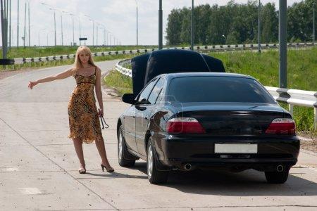 Woman and broken car.