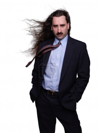 Photo for Fashionable businessman with long hair blowing in the wind - Royalty Free Image
