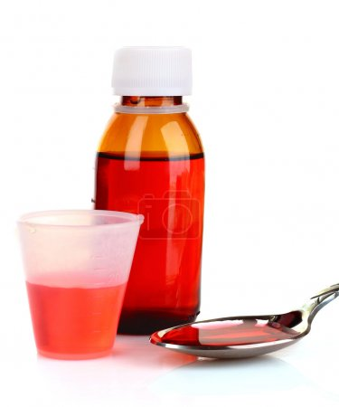 Cough medicine bottle with poured dose on counter...