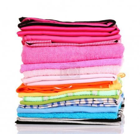 Pile of colorful clothes over white background...