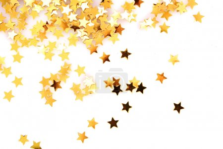 Photo pour Étoiles d'or sous la forme de confettis sur blanc - image libre de droit