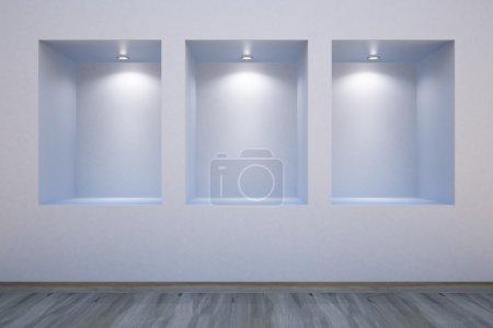 Photo pour Étagères vides dans un mur-honoré projecteurs - image libre de droit